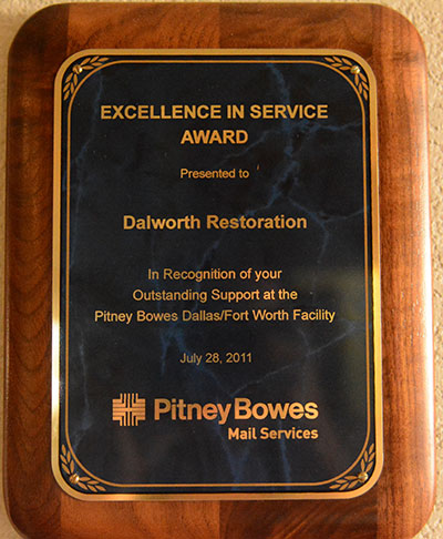 Pitney Bowes Gives an Excellence Service Award to Dalworth Restoration