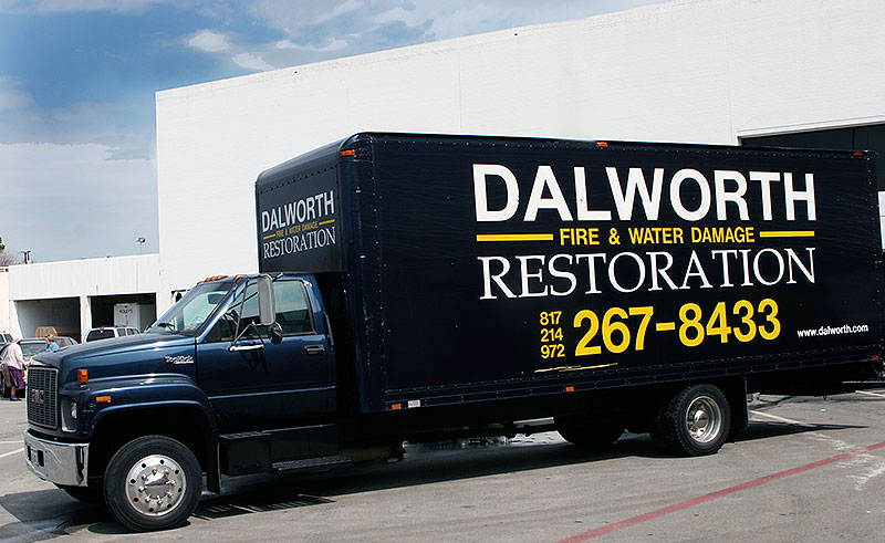Dalworth Restoration cleaning a sewage block and water damage at a commercial mall in Irving, TX.