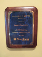 Dalworth Restoration receives exellence in service award from pitney bowes