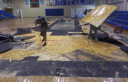 Dalworth technicians removing gym flooring