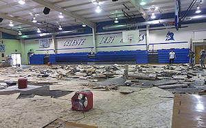 Water damaged flooring in a school's gym