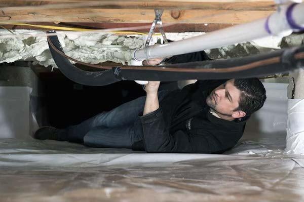project manager inspecting completed crawlspace