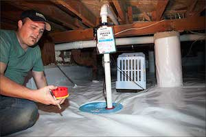 Project manager servicing crawlspace equipment