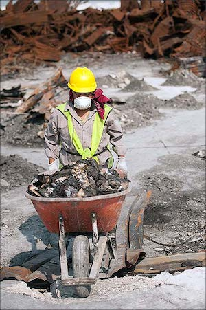 Commercial restoration worker clearing debris from a demolished building