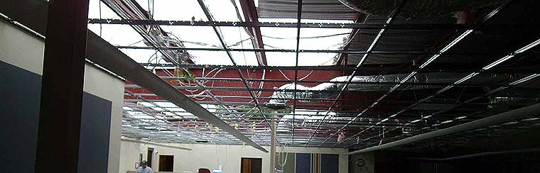 Storm damaged office building roof and water damage to interior