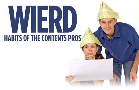 a man and woman with paper hats reviewing a document