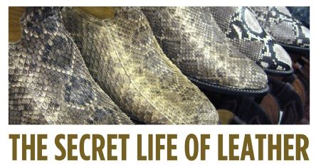 a photo of leather snake skin cowboy boots