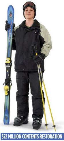 a person in ski clothes with ski equipment