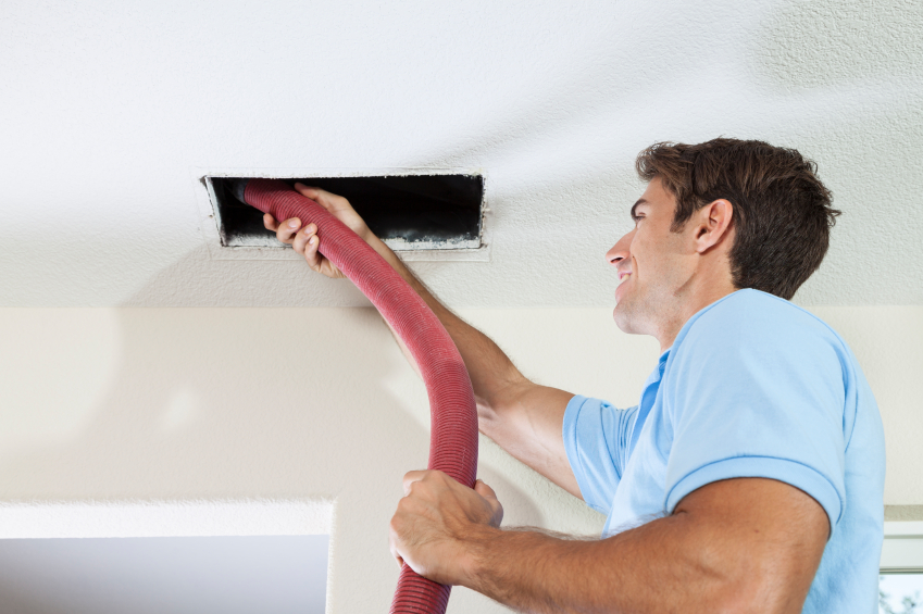 service-tech-cleaning-residential-ductwork