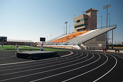 A track and field meet in session at the Aledo, TX Bearcat Stadium.