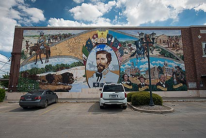 A 216 foot long, hand painted mural at Wright Plaza in Cleburne, TX was developed by a local artist as a memorial for Confederate General Patrick Cleburne.