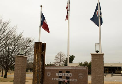 An artifact from the World Trade Center Towers, a 12-foot long beam weighing 2 tons, is permanently installed in memorial in front of the Euless, TX Fire Administration building.