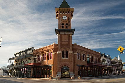 The Grapevine, TX Convention & Visitors Bureau Headquarters Glockenspiel Clock Tower reaches 127 feet above Main Street and features two larger-than-life Glockenspiel characters that emerge from the tower each day to enact a heist known as the Would-Be Train Robbers.