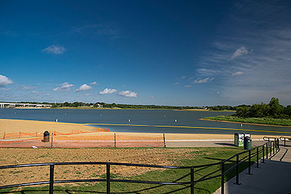 Little Elm Park serves as a public sand beach and swimming area that restricts boat access in Little Elm, TX.