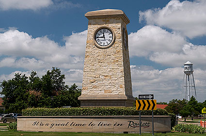 The Rowlett, TX city sign and vintage water tower in the distance.