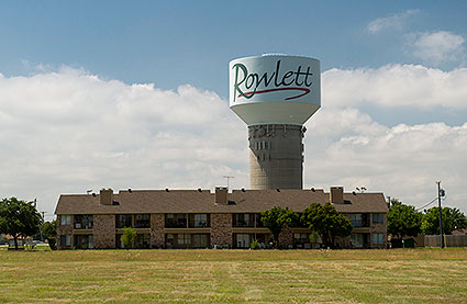 A water tower and residential living area in Rowlett, TX.
