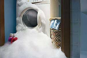 washing machine overflowing with water and soap